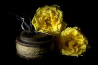 Two Yellow Roses and a Reel of String
